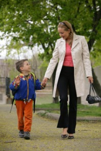 mom and child walking to school
